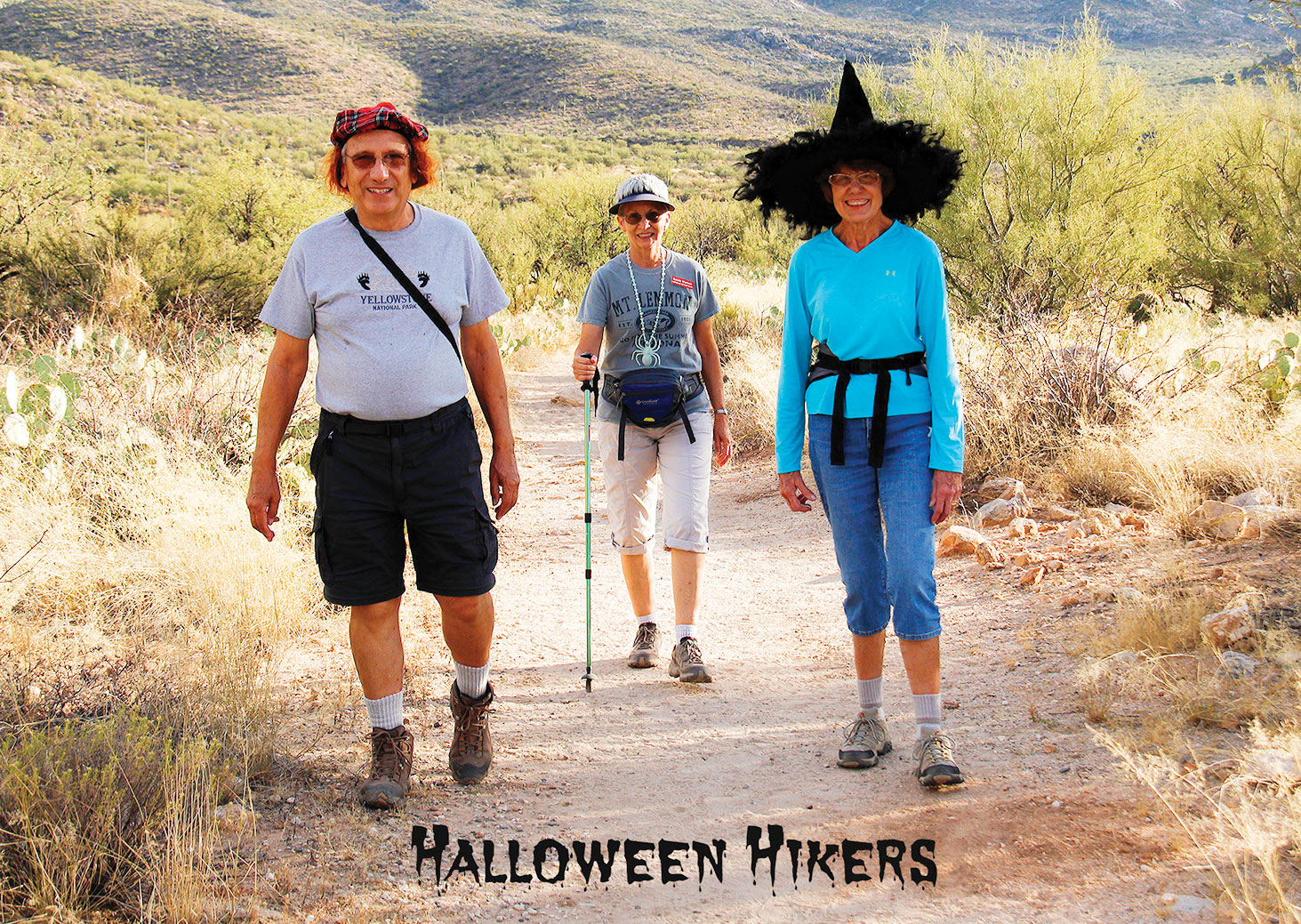 Halloween hikers are Michael Reale, Rainie Warner and Jan Springer; photo by Barbara Wilder