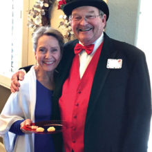 Vicki Tessatore and Ron Kari – one of Santa's serving elves and a grateful guest