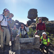 At the Big Balanced Rock in the Heart of Rocks area of Chiricahua National Monument are, left to right: Larry Linderman, Joe and Joyce Maurizzi, Aaron Schoenberg (guide), Niel Christenson and Jackie Hall; photo by Aaron Schoenberg