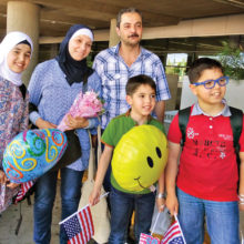 A family finds help with the help of the Refugee Ministry of Santa Catalina Catholic Church.