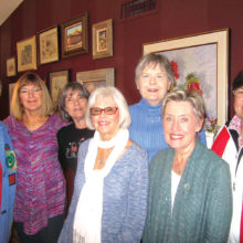Hardworking Chapter EP members meet to plan for the February 24 style show and luncheon.