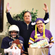 Left to right: Brooke McIntyre for the Dallas Cowboys, former NFL referee Pastor Steve Wilson and Carol Thompson for Minnesota Viking country