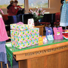 Some of the many items created by congregants of MSPC: dresses for African girls, gifts for the baby shower, Easter cards, hygiene bags for TCFB and a bundle of used clothing for the homeless.