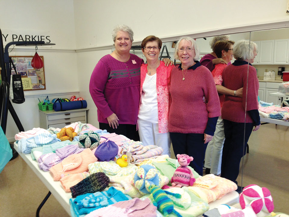 Beth Bradford, Georgiann Schwetz and Dianne Resseguie admire one table of baby donations.