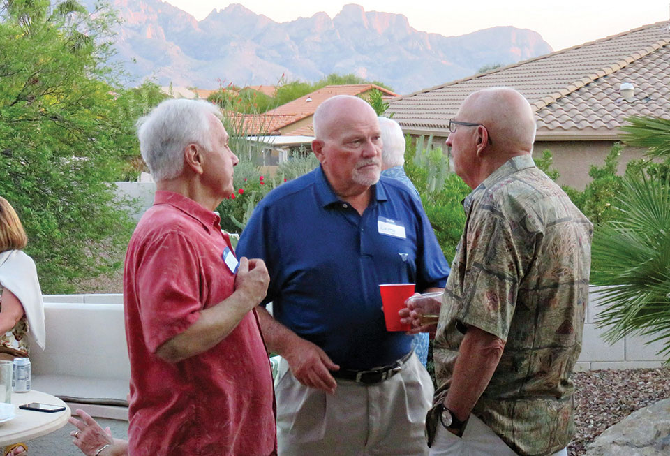 Neighborly discussion with beautiful mountain views; photo by Ron Talbot