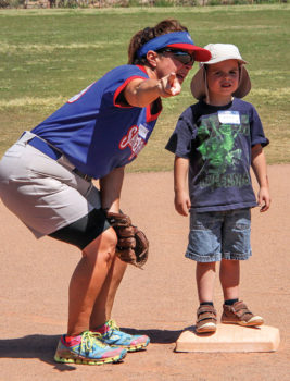 Coach Janice Mihora offers some guidance to young Travis; photo by Jim Smith.
