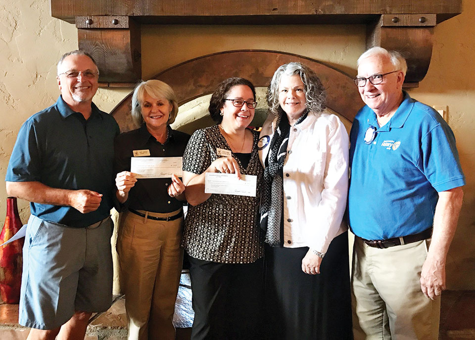 Ronald McDonald House check presentation, left to right:, SaddleBrooke Rotary Fore for Kids Event Chairman Robert Christadore, Director and CEO of Ronald McDonald House of Southern Arizona Kate Jensen, Director of Development Ronald McDonald House of Southern Arizona Nancy Kirk, SaddleBrooke Rotary Event Coordinator Wendy Guyton and President of SaddleBrooke Rotary and Joe Guyton