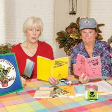 Susan Sterling and Shawne Cryderman look at scripts.