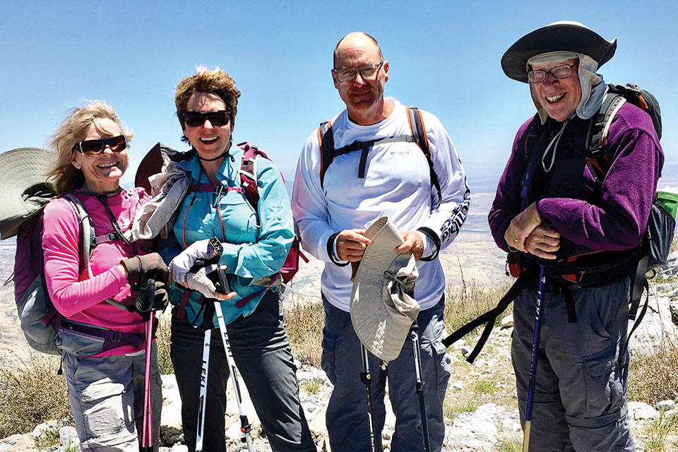Standing at the windy summit of Miller Peak in the Huachuca Mountains are (left to right) Bertie Litchfield, Donna Canon, Pete Canon and Aaron Schoenberg; not pictured are Frank Earnest and Don Taylor.