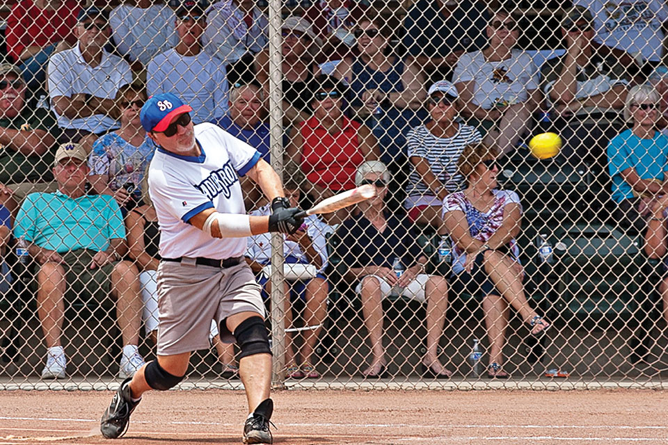 Greg Morgan's walk-off grand slam homer leaves his bat at the SSSA Memorial Day Tournament. Seconds later the crowd was on its feet applauding the exciting finale; photo by Dennis Purcell.