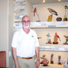 Mark Erickson with some of his beautiful birds