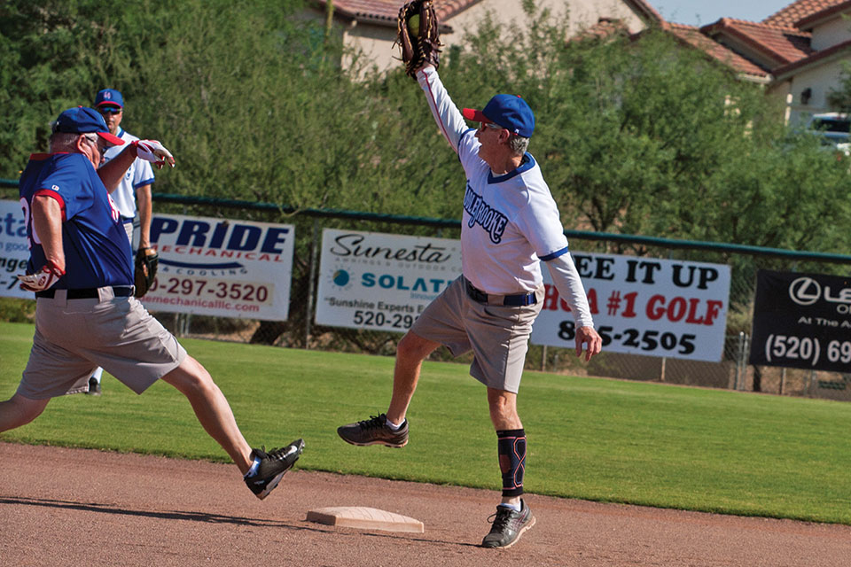 Recreation: Second baseman Dennis Purcell leaps to catch the throw as Dale Norgard stretches to reach second base safely; photo by Cathy Purcell