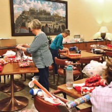 Volunteers from Unit 48 wrapped presents for the SBCO Adopt a Child program in 2016.