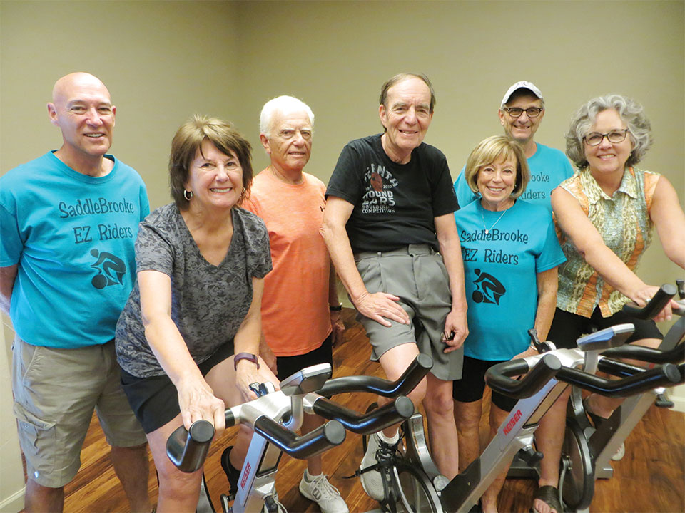 Three new EZ Riders, front, left to right: are Linda Ryan, Ted Reingold and Deanna McCann. Back row, four of the EZ Rider leaders: Keith Dickmann, Sy Efron, Marje Valenti and Gary Haslett
