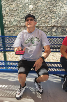 Ken Powers tries to bounce the white ball on the mini-paddle multiple times in a row; photo by Shawne Cryderman.