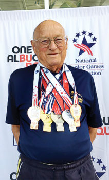Harold Peter with his winning medals; Photo by Gisela Peter