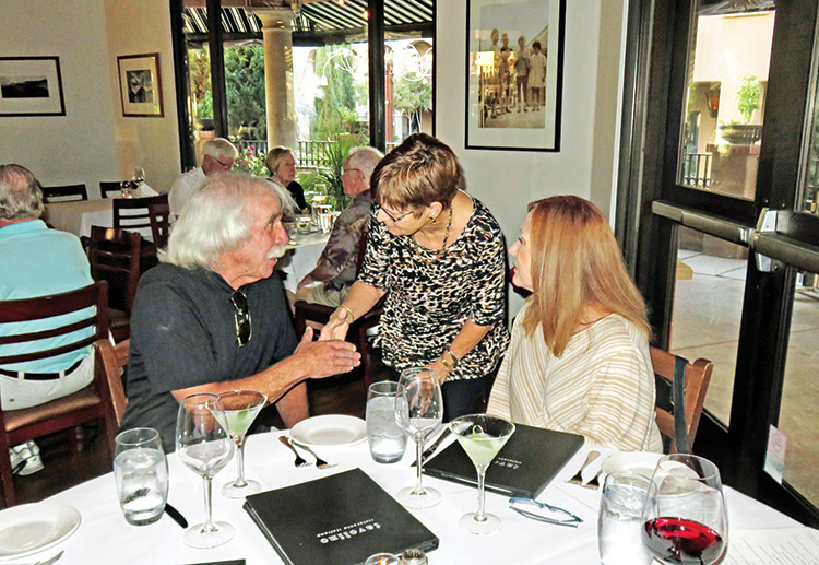 A chance to mix and mingle at Tavolino's. Photo by Ron Talbot.