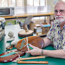 Mark Erickson with many of his handcrafted works. Photo by Russell C. Stokes.