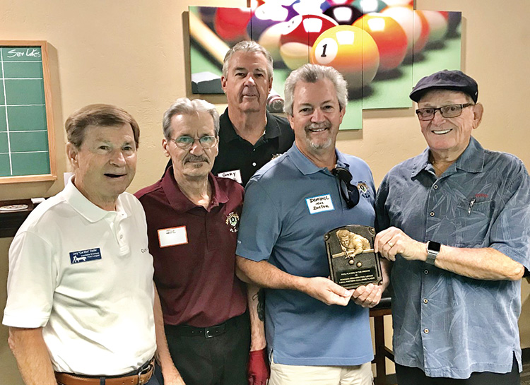 "Willie ""The Wizzard"" Foster, Iron Oaks Breakers Pool League's Travel Team Coordinator from Sun Lakes (far right), handing over the Bronze Plaque to Dominic ""The Doctor"" Borland PPB Travel Team Captain, while Larry ""CueStick"" Stadler, president of The Iron Oaks Breakers Pool League (far left), and Joe ""Fast Eddie"" Giammarino, president of the PPB (second from left), and Gary ""One Rail"" Barlow, PPB Travel team co-captain, (center) look on."