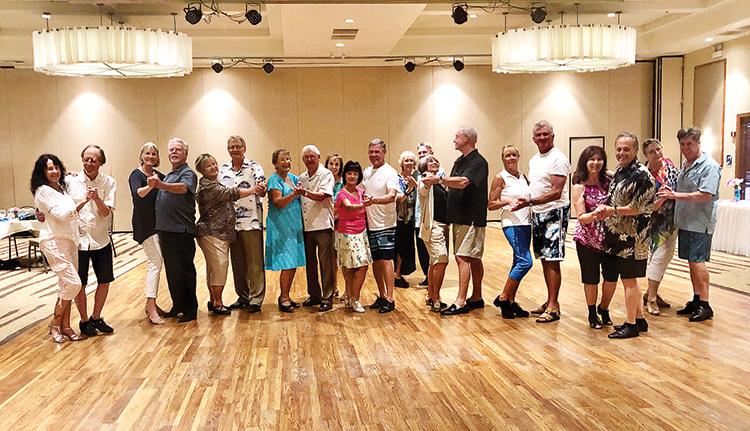 Dancers enjoy a dance party.