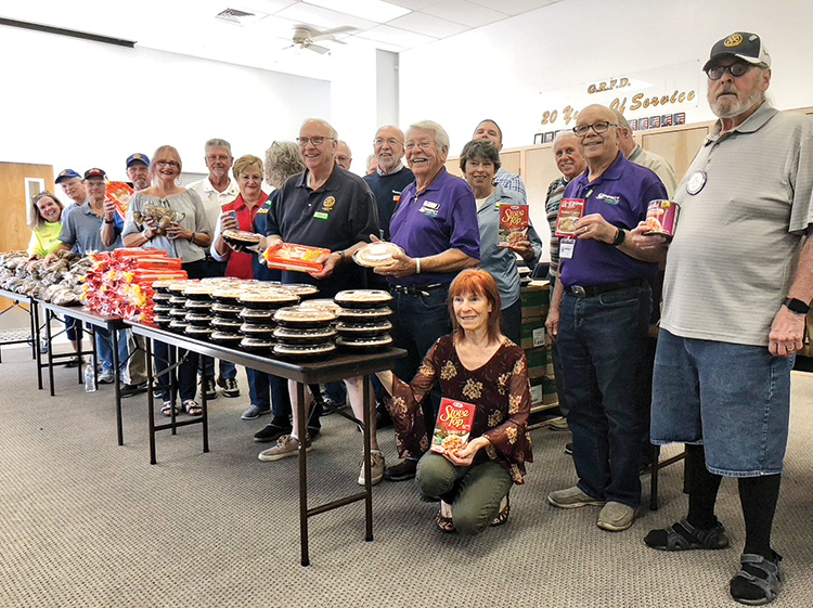 Members of the Rotary Club of SaddleBrooke team up with the board of directors of IMPACT of Southern Arizona, the Golder Ranch Fire Department, and the Elks Lodge to help provide Thanksgiving dinners for area residents in need.