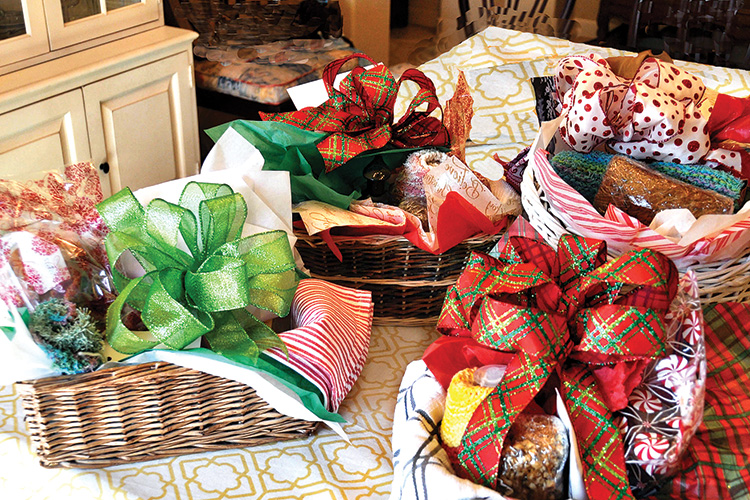 Colorful holiday baskets, prepared by Senior Village volunteers, await delivery thanks to donations to the Village Gift Fund.