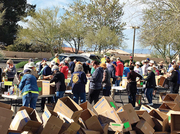 Each year, SBCO Food Drive volunteers sort, box, and deliver thousands of pounds of donations to Tri-Community Food Bank.