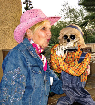 Pat Olson having fun with a spooky Halloween musician at Karen and Don Erickson's house; photo by Ron Talbot.