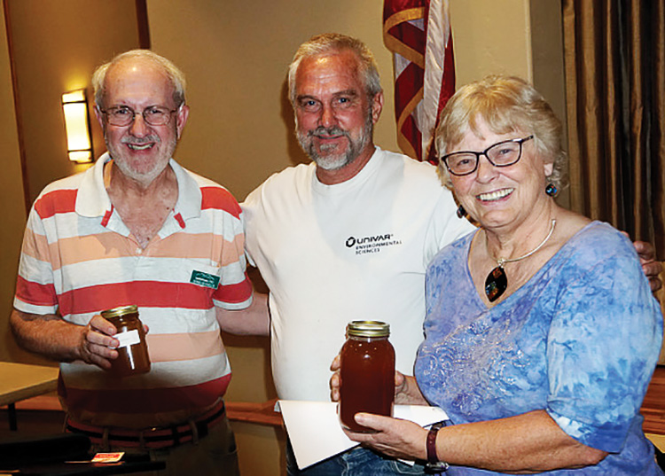 Don Grafmiller and Darlene Carlson won honey from speaker Steven Thoenes.