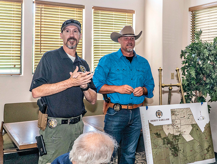 """Region B Commander Lt. Eli Pile and Pinal County Sheriff Mark Lamb responding to questions from the attendees at the July, 2019 """"Coffee with a Cop"""" event. Lt. Pile's Region B includes all of SaddleBrooke"""