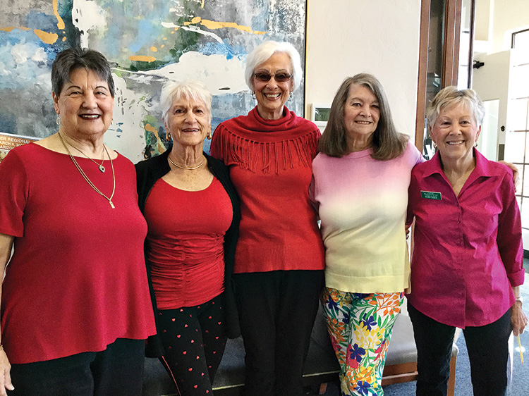 Bridge players celebrated Valentine's with brightly-colored clothes. Sharon Wyles, Midge Miller, Marian Rogge, Vicki Hanson, and new member Barb Kiser cheered up the room.