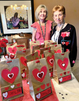 Sandy Valenzuela and Gerry Burnside with Valentine's goodie bags.