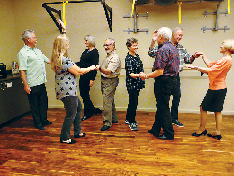 Roger and Linda Shamburg, Charla Blacker, Dan Eggleston, Peg and Joe Tomlinson, Dick Dunbar, and Bertie Litchfield practicing their dance lesson.