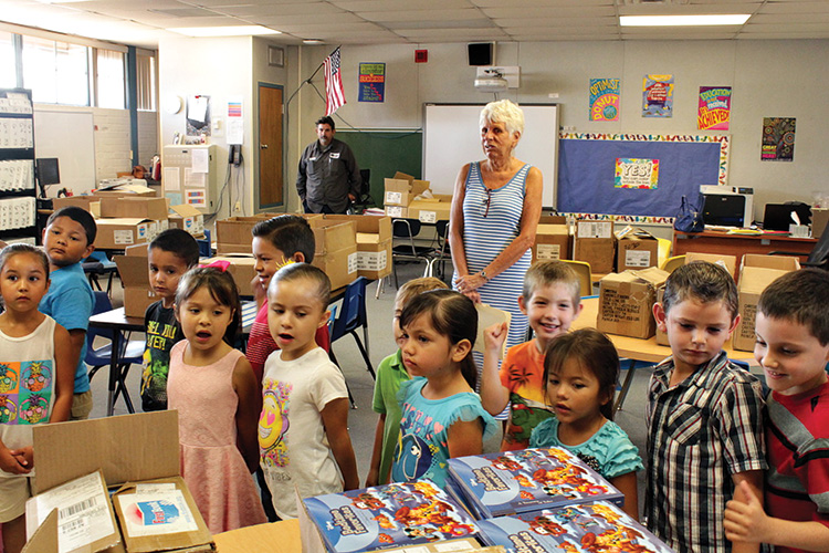 There is so much joy and excitement in the eyes of the children as they look at the books they will receive.