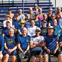 Teammates enjoy the sunshine at the swim meet.
