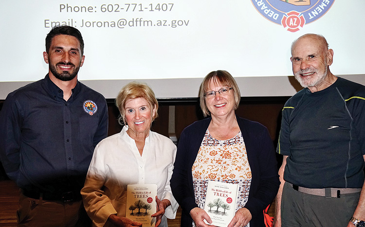 Speaker John Orona and door prize winners Karen Pachis, Shannon Martinell, and Richard Ewing (Photo by Ed Skaff)