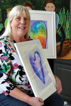 """Theresa Poalucci displays work from her """"Hearts"""" series of alcohol ink paintings."""