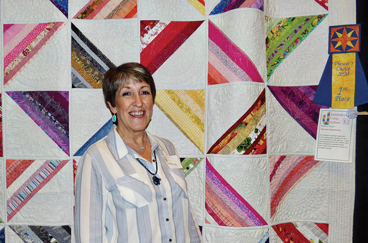 "Pat Morris was the runner-up for the People's Choice Award with her quilt, ""Lollipop Trees."""