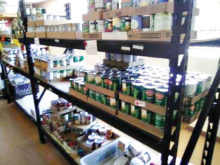 At the Tri-Community Food Bank, located in Mammoth, volunteers unload products and place them on shelves for easy access.