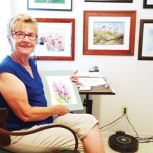 Sue Wilson shows a watercolor she completed in an online class during our stay-at-home season.