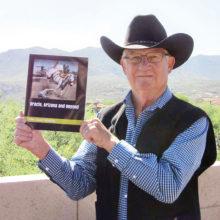 Stuart Watkins with his book