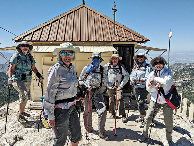 Hikers pose by the Fire Lookout Cabin. (Photo by fire ranger Jeff)