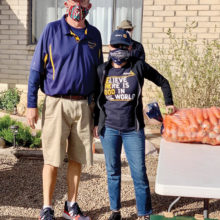 Dan Watson and Liese Razzeto of The Rotary Club of SaddleBrooke help with produce distribution.