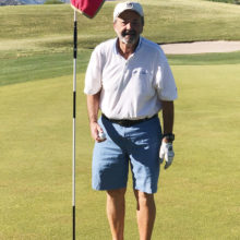 Rich Wilson standing by the third hole flag on the Catalina course at SaddleBrooke (Photo by Bob Eder)