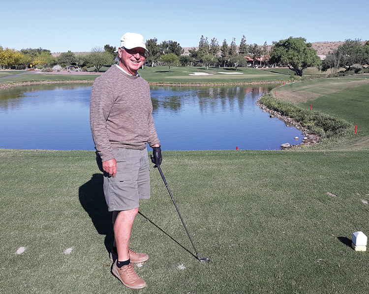 Michael Hovan standing on the tee with the green in the background (Photo by Fred Pilster)