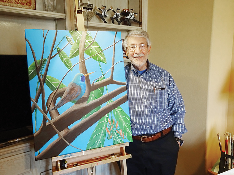 Howard Cohen displays his recently completed work, Hummingbird at Rest. (Photo by LaVerne Kyriss)
