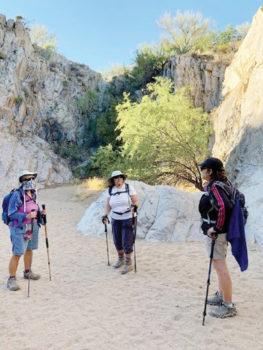 Carol Burke, Karen Gray, and Yvette Sibulsky looking at high walls in Honey Bee Canyon (Photo by Elissa Cochran)