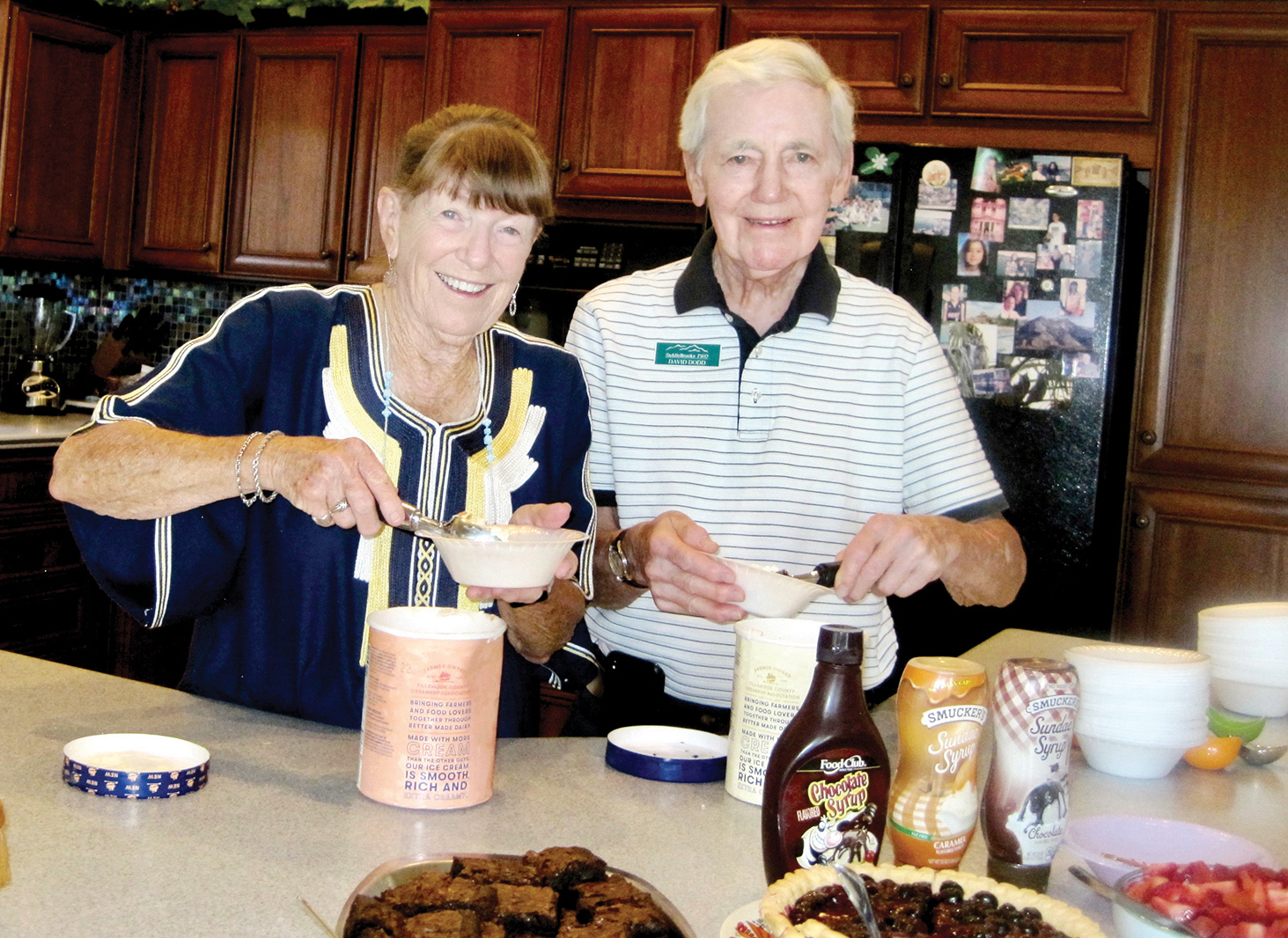 Arlene DesJardins and David Dodd serving up dishes of ice cream