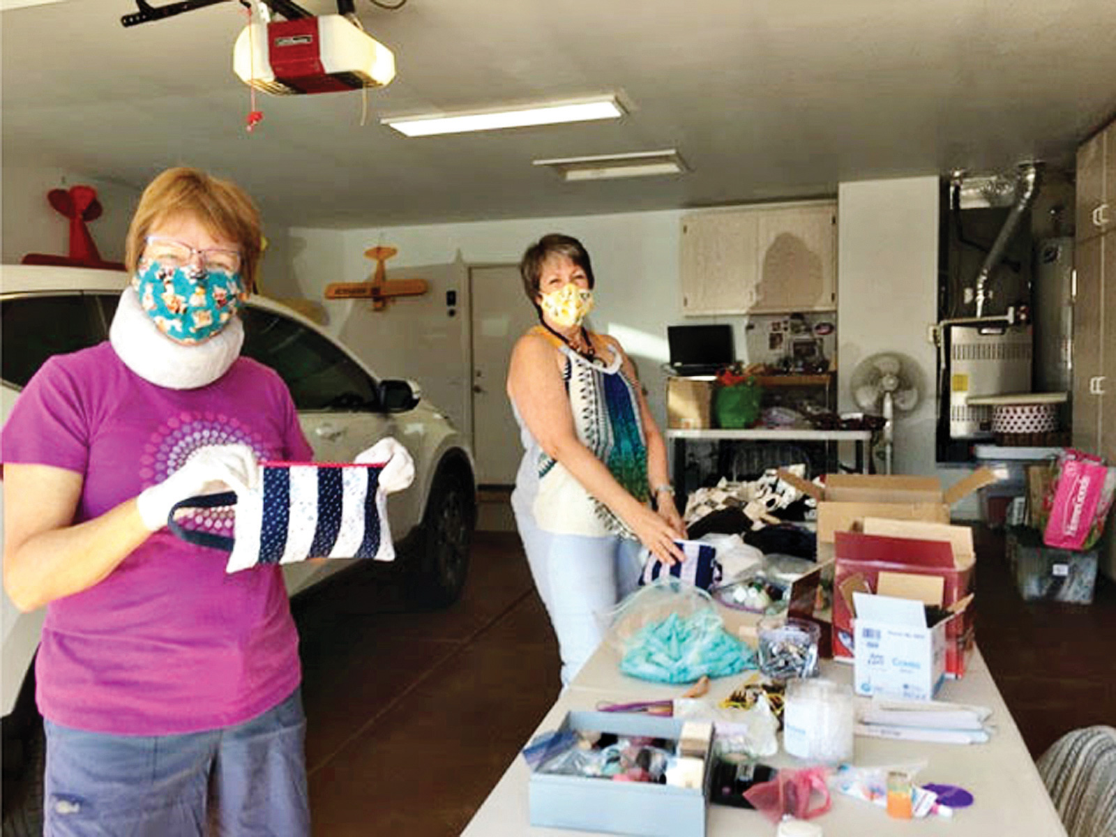 Kris Prass and Athena Taylor making hygiene bags for Youth on Their Own students