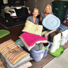 Linda Crum delivering dog beds to Mera Laurey of Friends of Pinal County Animal Shelter & Rescue.